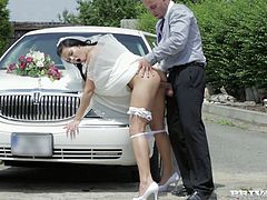 Scorching hot black haired bride Victoria Blaze bends over the car's hood and takes bestman's fat cock up her shaved cunt doggystyle.