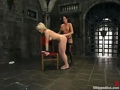 Nice blonde chick in white lingerie licks Melissa's toes and then gets spanked. Later on she gets tied up and pounded with a strap-on.