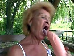 Salacious blonde granny Francesca is playing dirty games in the garden. She pleases herself with fingering and then uses a massive dildo to drill her snatch.