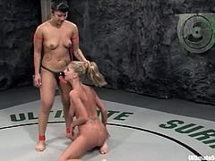 Asian lesbian DragonLily is having a battle with Sammie Rhodes on tatami. The chicks wrestle with each other and then DragonLily pounds Sammie's cunt with a strapon.
