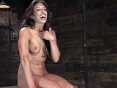 Hot brunette milf Gina Caruso is having fun with a man in a cellar. She lets him tie her up and gets an orgasm while being tormented.