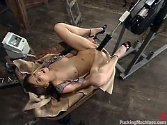 Slim girl in a cowboy hat toys her pussy with a dildo and then also uses a fucking machine. She gets her wet pussy drilled deep and hard.