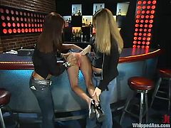 Hollie Stevens, Isis Love and one more girl are playing BDSM games outdoors. The petite blonde allows her GFs to tie her up and then gets her mouth and pussy smashed with a strapon.