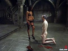Horny Asian girl in fishnets and lingerie bounds John in a basement. After that she tortures his dick with claws and straps.