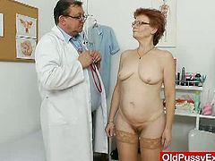 Old Pussy Exam brings you an exciting free porn video where you can see how a redhead mature slut gets her hairy pink pussy playfully examined by her doctor.