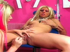 Long haired naked and playful blonde nymphos with natural tits and colorful heavy make up spread long legs and pleasure each other with glass dildo to wet intensive orgasms.