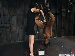 Stacey Cash gets bound by some dominant chick in a basement. Then she gets her ass decorated with wires and plays with a fucking machine afterwards.
