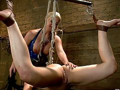 Blonde mommy Phoenix loves redhead chicks, that need a good punishment. Cheyenne is one of those girls and she's not gonna get away easily! The blonde tied and partially hanged the redhead, gave her that big juicy ass for some licking and then, took care of her pussy. Wanna see how she made her obedient?