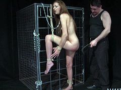 This cruel bondage master knows how to make punishment effective. He spanks his slave's ass hard until it turns scarlet red. Then he fucks her from behind.