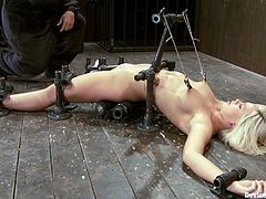 That is the device bondage here! Smoking hot blond angel Tara Lynn Fox gets trapped on the floor and her nipples are tagged by the help of twitches!