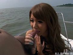 Stunning Japanese girl in bikini has fun on the boat. She shows her nice tits to a guy and gives him an amazing blowjob & titjob combo.
