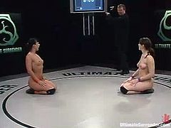 Two nasty brunette chicks in bikini wrestle and then have hardcore lesbian sex. Nasty Juile sucks a dildo and then gets toyed deep in her soaking pussy.