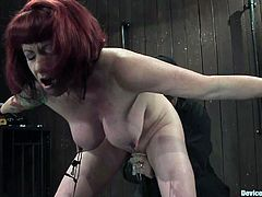 Going back to good old times is what Kylie Ireland is for. She gets tied up on the iron bars and her huge boobs get tugged down with ropes attached on her tits with twitches!