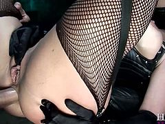 Seductive brunette MILF with big boobs is wearing sassy leather costume. Her outfit consists of tight corset, fishnet stockings and leather jackboots. She takes hard stick in her throbbing anus. She is a big lover of anal sex.