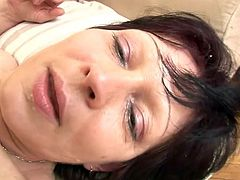 Salacious brunette mom Eva wearing a corset and fishnet stockings allows some guy to finger and toy her vag. Then they fuck in side-by-side position and Eva moans loudly with pleasure.