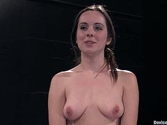Kinky brunette Winter Sky is having fun with a guy in a basement. She gets tied up and doesn't mind the dude putting weights on her tits.