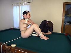 This gorgeous and super naughty siren is so fucking hungry for pain! She gets on the pool table naked and enjoys some pain.