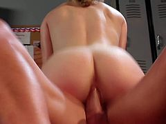 Pale blonde slut Lily Labeau with natural tits and tight ass gives head to tanned Eric Masterson with hot body and rides on his cock on bench in locker room.