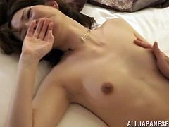 Sleeping Japanese chick in lingerie gets her tits and pussy fondled. After that she wakes up and gives a blowjob. She also gets fucked in a missionary pose.