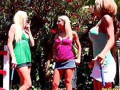 Sexy blonde babe Corie Nixx and her GFs play golf and get tired. The cuties go to the living room and stroke each other's big fake tits and then eat each other's pussies and drill them with dildos.