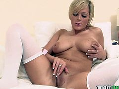 Blonde sweety is wearing sexy pink lingerie and white nylon stockings. She looks like beautiful doll. She gets naked caressing her body sensually. She then slides smooth dildo against wet slit. Hey fellas, you gotta watch this clip. She's fucking awesome.