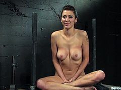 Gorgeous brunette milf Princess Donna Dolore is having fun with some guy in a basement. She lets the man put her into irons and then undergoes some tortures and gets a strong orgasm.