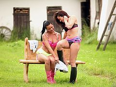 Sexy babes have a lesbian scene outdoors