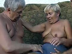Dirty and kinky granny is lying naked on a couch. She is getting her slick cunt rubbed and fingered actively. She also gives head to horny old daddy.