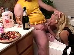 Salacious blonde milf is playing dirty games with some dude in a bathroom. She licks his wang and balls hungrily and seems to be unable to stop.
