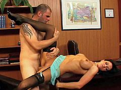 Black haired Roxane Hall with awesome fit body and perfectly shaped fake tits in stockings and high heels seduces pale Ralph Long and gets nailed on desk in her office.