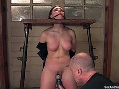 This desirable brunette babe loves being treated tough. She gets collared and bent over by Mark. Then he invades her vagina with his stiff dagger!