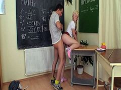 Pigtailed blonde teen gets banged in the classroom