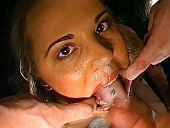 Slutty babe receives large cocks to play with during nasty anal gang bang show