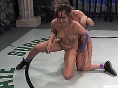 Two hot chicks fight in a battle showing great desire to win. Isis shows a little bit more aspiration to win, that is why she fucks Ava with a strap-on.