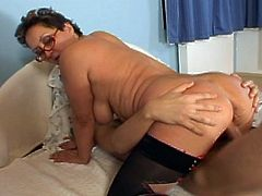 Brunette granny gets in the middle of two hard young cocks. She gets stripped down her sexy stockings. Her perverted side takes her and enjoys getting double fucked in all her holes.