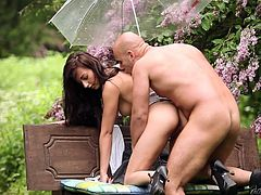 Have a look at this hardcore scene where this beautiful brunette is fucked outdoor by a guy on a park bench.