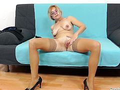 Czech mature Karen looks good in her black dress, but she looks even better naked and with her legs spread. The blonde undresses for us and remains only in her stocking and high heels. She then takes a sit on the couch, spreads her legs and her pussy. Her pink & juicy cunt could use a big dildo inside it