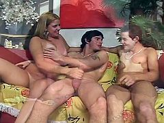 Two horny latin dudes are ready to enjoy a hardcore threesome together. Young blonde chick switches turns to take their cocks, but they also bang each other hard.