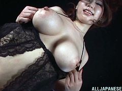 Curvaceous Japanese MILF in black lingerie and fishnets in hot solo show. She shows her juicy boobs and nice ass. Then she also fondles her bald pussy.