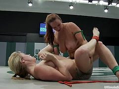 Two horny lesbians Adrianna Nicole and Bella Rossi are tussling with each other on tatami. They beat each other furiously and then the winner fucks the loser's cunt with a strapon.
