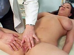 Cutie obeys her doc and lets him stretch that shaved twat in a staggering way