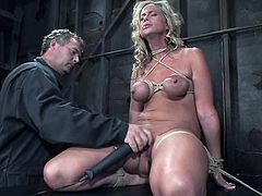 Busty blonde chick gets tied up and gagged by her master. After that he twists her boobs with ropes and fixes pumps. Then he also toys her vagina with a vibrator.