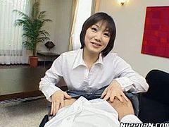 Cute Asian chick gives head to her boss right in the office