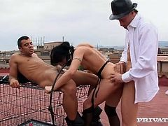 Submissive sex slave is sucking hard dick vigorously. The other guy slides his dick in her butt hole from behind meanwhile. Hardcore gangbang fuck film including BDSM elements.