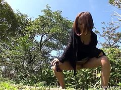 Sexy Japanese milf is having fun with some dude outdoors. She shows him her great natural boobs and then kneels in front of the stud and milks his schlong dry.
