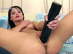 Kinky minded brunette sexpot masturbates with monster dildo
