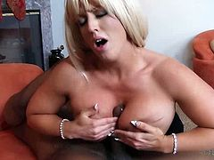 Just look at this sizzling and smoking hot blond milf! She got the proper size tits to his huge cock! And she blows it for some orgasm!