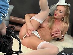 Naughty blond porn babe Sylvia looks gorgeous in her white stockings and thongs. Babe rubs her shaved cunny with her legs wide open and strokes her natural boobs.