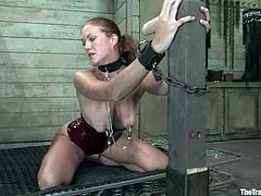 What can be worse than being forced to harm yourself. But on the other hand this amazing redhead sex slave seems to love it!