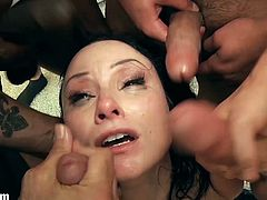 Dark haired and really naughty pale girl with a tattoo and nice boobs Veruca James gets her shaved taco as well as her throat rammed really hard by tons of men.